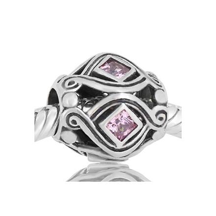 Abalorio con piedras rosas